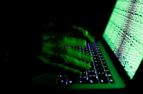 FILE PHOTO: A man types on a computer keyboard in front of the displayed cyber code in this illustration picture taken on March 1,  2017. REUTERS/Kacper Pempel/Illustration/File Photo